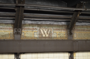 In every subway station I have seen the names of the stations have been in tiles like this