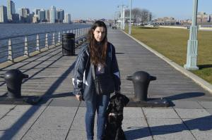 Blind Beader and her guide dog, Jenny at a pier in New York